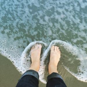 August: Always happy with my feet in an ocean (Myrtle Beach).